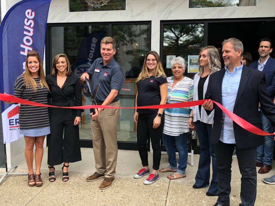 ERA Team VP cutting the ribbon for the new office location in Jamestown, NY